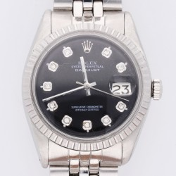 Rolex Datejust with diamonds and an additional silver shield
